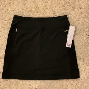 NWT. Cutter and Buck Black Skort Size S.